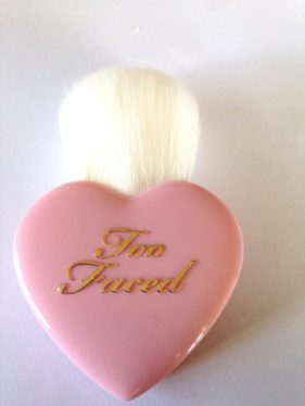 Too-Faced-Let-It-Glow-Highlight-and-Blush-Kit-Review-Brush-Swatches-519x692.jpg
